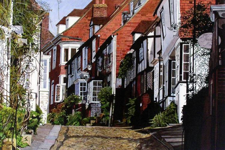 SPRING UP MERMAID STREET, RYE Spring sunshine on the cobbles walking up Mermaid Street in Rye, East Sussex. Jeakes House is on the right and the Mermaid Inn is further up on the left, round the corner